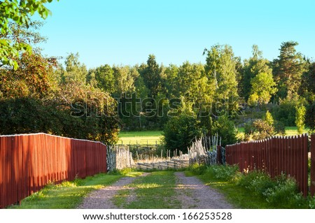Dirt way in a village in the woods of Smaland, Sweden - stock photo