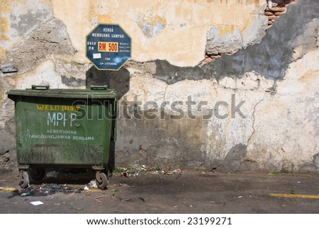dirty alley with sign - stock photo
