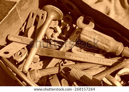 dirty and broken tools in a box, closeup of photo