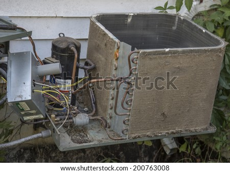 Dirty and clogged air conditioner condenser cooling fins - stock photo