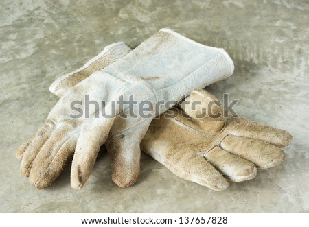 Dirty and old leather glove