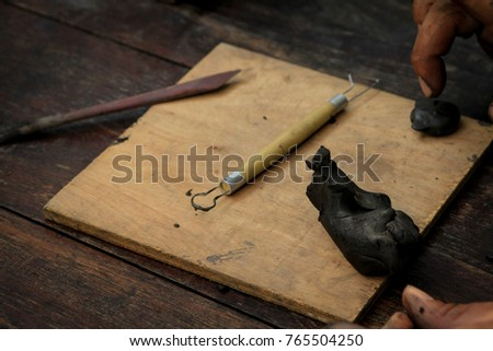 Dirty Art And Craft Sculpting, Pottery Tools With Clay On Wooden Table In  Pottery Workshop