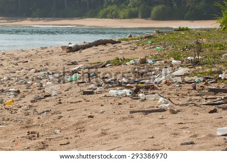 Dirty beach on the island of Little Andaman in the Indian Ocean littered with plastic. Pollution of coastal ecosystems, natural plastic and beaches. - stock photo
