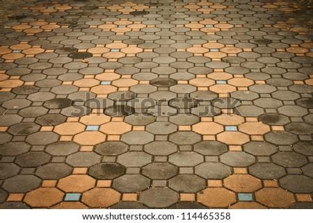 Dirty bricks street background - stock photo