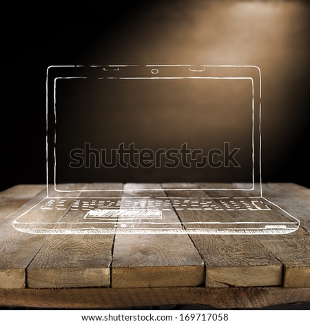dirty brown wall and laptop  - stock photo