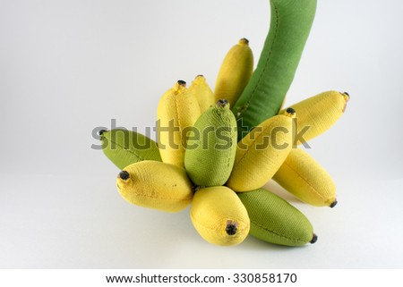 Dirty bunches of ripe bananas doll on white background.