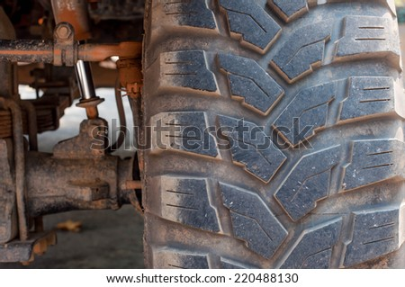 Dirty car's wheels in off-road - stock photo