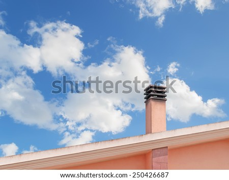 dirty chimney of an orange country house