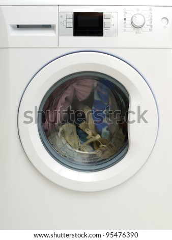 Dirty clothing being washed in washing machine
