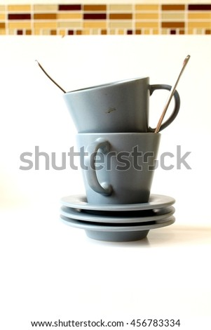 dirty coffee cup on white background - stock photo