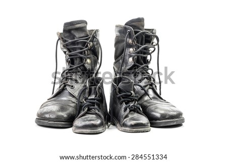 Dirty combat boots for adult and kid isolated on white background with clipping path - stock photo