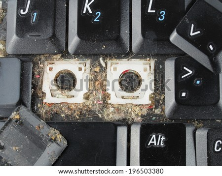 Dirty computer keyboard with keys removed for cleaning - stock photo