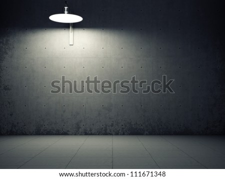 Dirty concrete wall illuminated by lamp - stock photo