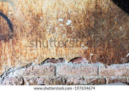 Dirty concrete wall with big crack - stock photo