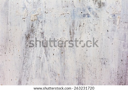 Dirty concrete wall with yellow streaks of water, cracks and scratches. Grungy concrete surface. Great background or texture for your project. - stock photo