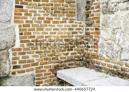 dirty corner with rustic  brick wall and granite seat