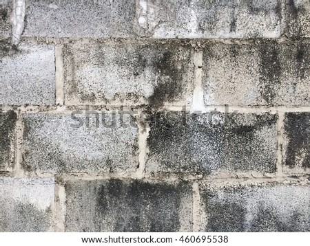 Dirty dark concrete block wall texture background