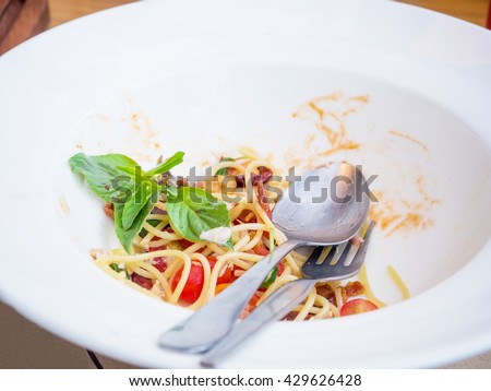 Dirty dish of spicy spaghetti after eaten - stock photo