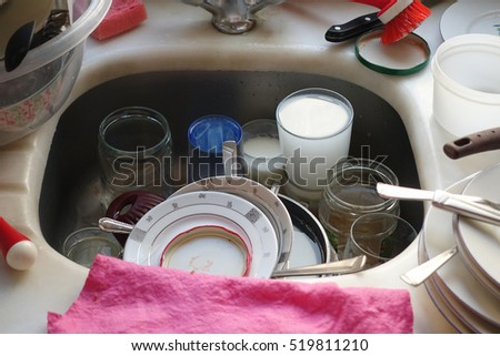dirty dishes in a kitchen sink