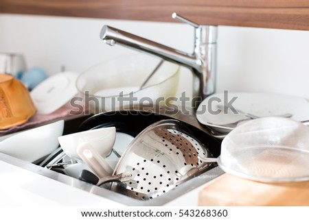 Dirty dishes in the sink to be washed