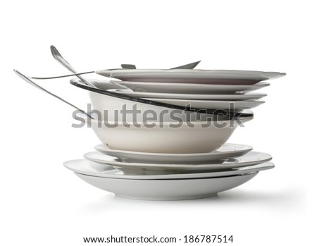 Dirty dishes isolated on white with clipping path - stock photo