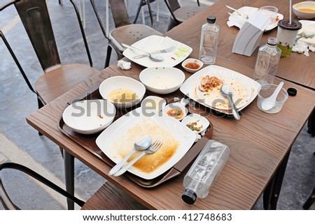 dirty dishes on a table in a restaurant