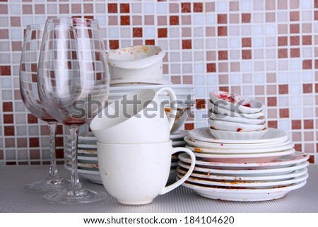 Dirty dishes on bright background - stock photo