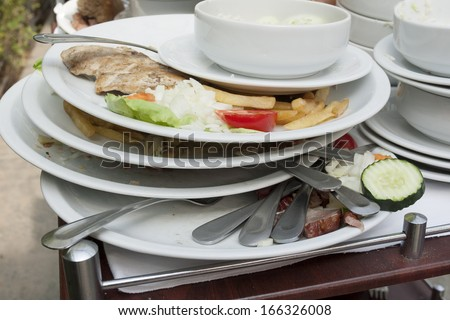 Dirty dishes waiting for washing.  - stock photo