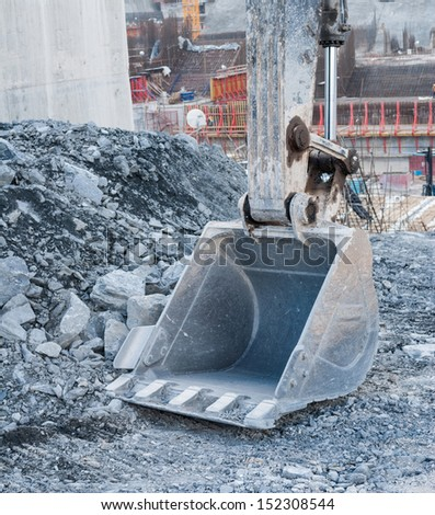 Dirty excavator shovel or bucket at Construction Site - stock photo