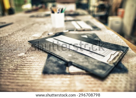Dirty folders and paper on a table, industrial environment. - stock photo