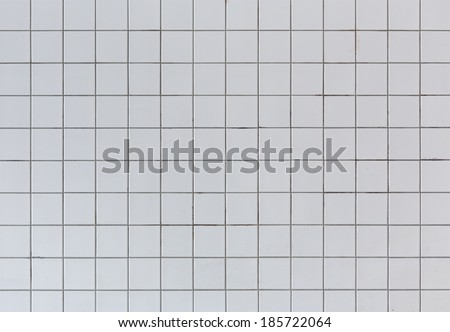 Dirty grey ceramic tile wall texture - stock photo