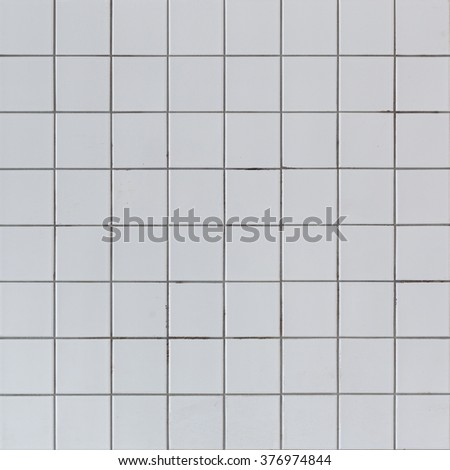 Dirty grey ceramic tile wall texture, outdoor background. - stock photo