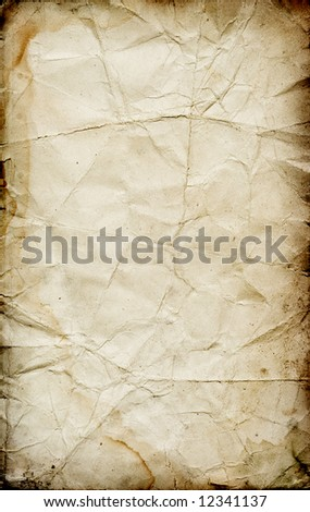 Dirty grunge damaged vintage paper texture with stains and dark borders - stock photo