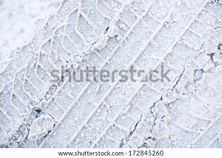 Dirty grunge tyre track on snow texture - stock photo