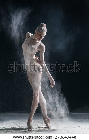 dirty in flour dancer posing on a studio background - stock photo