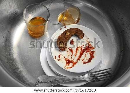 Dirty kitchenware in kitchen sink closeup - stock photo