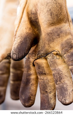 Dirty leather gloves ground work and scratches - stock photo