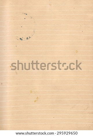 Dirty lined paper with coffee cup stain and marks background - stock photo