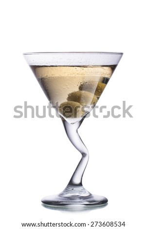 Dirty Martini alcoholic cocktail with olives inside the glass with bent leg - stock photo