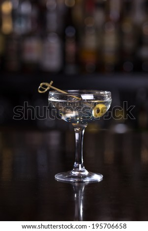 Dirty martini cocktail on the bar - stock photo