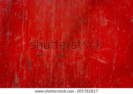 dirty metal surface painted in red color illuminated by sunlight