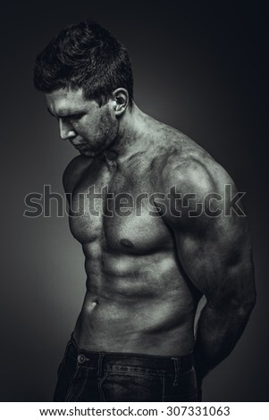 Dirty muscle man in pose on BW photo