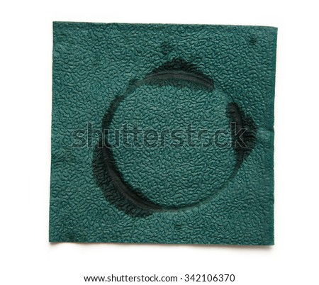 Dirty napkin in closeup isolated on white background