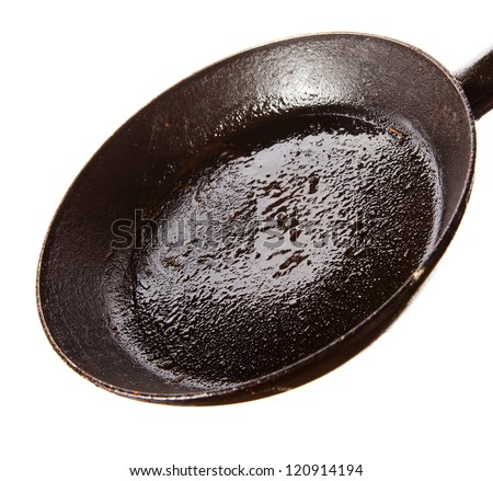 Dirty oily  pan after frying close up image over white background - stock photo