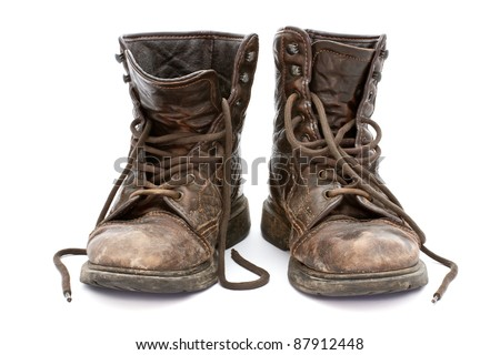 Dirty old boots isolated over white background
