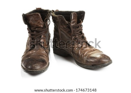 Dirty old boots isolated. white background - stock photo