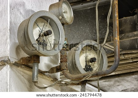 Dirty old pressure three gauges. - stock photo