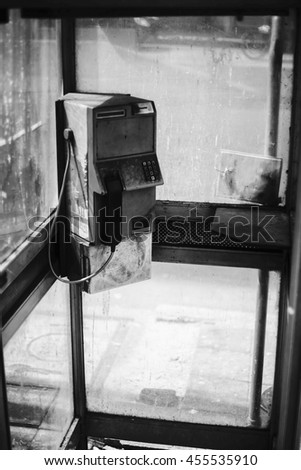 dirty old public telephone in thailand,black and white color picture style,selective focus,neglected item in thailand - stock photo