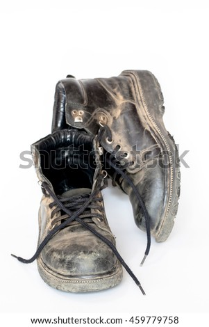Dirty Old Shoes on White Background