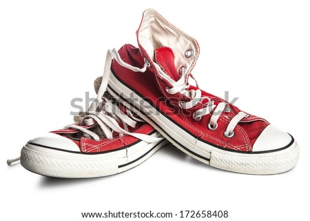 Dirty old sneakers isolated on white - stock photo